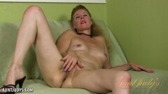 Seductive babe plays with her pussy Thumb