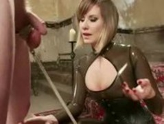 Perverted lady with sexy tits and outfitted in leather whipping s Thumb